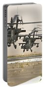 A Group Of Ah-64d Apache Helicopters Portable Battery Charger