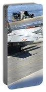 An Fa-18e Super Hornet Lands Aboard Portable Battery Charger