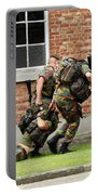 Soldiers Of The Belgian Army Helping Portable Battery Charger by Luc De Jaeger