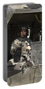 A Uh-60 Black Hawk Door Gunner Manning Portable Battery Charger
