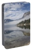 mist burning off Lake Bohinj Portable Battery Charger