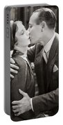 Silent Film Still: Kissing Portable Battery Charger