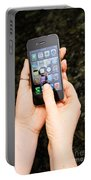 Hands Holding An Iphone Portable Battery Charger by Photo Researchers, Inc.