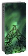 Powerlines And Aurora Borealis Portable Battery Charger by Arild Heitmann