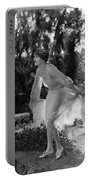 Silent Film Still: Woman Portable Battery Charger
