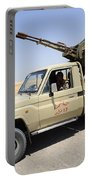 A Free Libyan Army Pickup Truck Portable Battery Charger by Andrew Chittock