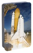 Space Shuttle Atlantis Lifts Portable Battery Charger