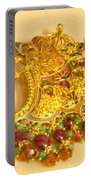 A Beautiful Intricately Carved Gold Pendant Hanging From A Semi-precious Stone Chain Portable Battery Charger