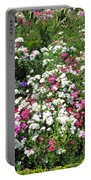 A Bed Of Beautiful Different Color Flowers Portable Battery Charger