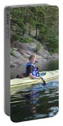 A Boy Kayaking Portable Battery Charger