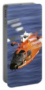 A Coast Guard Hh-65a Dolphin Rescue Portable Battery Charger by Stocktrek Images