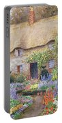 A Cottage Garden In Full Bloom Portable Battery Charger