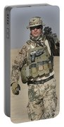 A German Soldier Carries A Barrett Portable Battery Charger