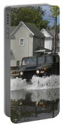A Humvee Drives Through The Floodwaters Portable Battery Charger
