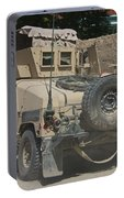 A Humvee Patrols The Streets Of Kunduz Portable Battery Charger