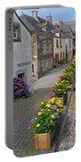A Line Of Flowers In A French Village Portable Battery Charger