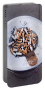 A Lot Of Cigarettes Stubbed Out At A Garbage Bin Portable Battery Charger