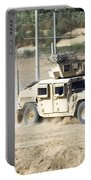 A M1114 Humvee Patrols The Perimeter Portable Battery Charger