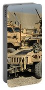 A M1114 Humvee Sits Parked In Front Portable Battery Charger