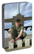A Marine Replaces Flares In Flare Portable Battery Charger