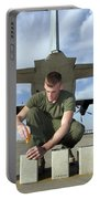 A Marine Replaces Flares In Flare Portable Battery Charger by Stocktrek Images