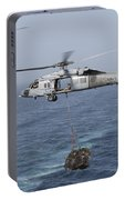 A Mh-60s Knighthawk Transfers Cargo Portable Battery Charger