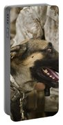 A Military Working Dog Sits At The Feet Portable Battery Charger by Stocktrek Images