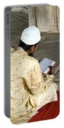 A Pious Devotee Reading The Quran Inside The Jama Masjid In Delhi Portable Battery Charger