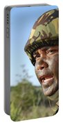 A Royal Brunei Land Force Soldier Portable Battery Charger by Stocktrek Images