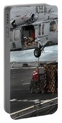 A Sailor Hooks Cargo To An Mh-60s Sea Portable Battery Charger