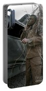 A Scout Observer Applies Camouflage Portable Battery Charger by Stocktrek Images