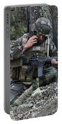 A Soldier Communicates His Position Portable Battery Charger