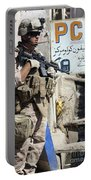 A Soldier Provides Security Portable Battery Charger