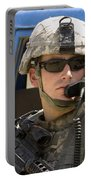 A Soldier Talking Via Radio Portable Battery Charger by Stocktrek Images