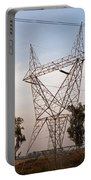 A Transmission Tower Carrying Electric Lines In The Countryside Portable Battery Charger