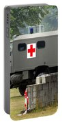 A Unimog In An Ambulance Version In Use Portable Battery Charger by Luc De Jaeger
