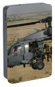A U.s. Air Force Hh-60 Pavehawk Flies Portable Battery Charger