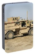 A U.s. Army Cougar Mrap Vehicle Portable Battery Charger
