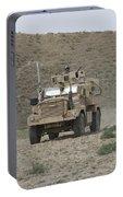 A U.s. Army Cougar Patrols A Wadi Portable Battery Charger