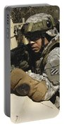 A U.s. Army Soldier Pulls Security Portable Battery Charger