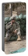 A U.s. Army Soldier Talks On A Radio Portable Battery Charger