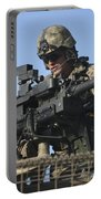 A U.s. Marine Fires A Gmg Automatic Portable Battery Charger
