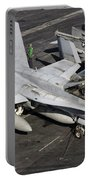 A Us Navy Fa-18c Hornet Parked Portable Battery Charger