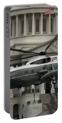 A Vh-60 Helicopter Lands In Front Portable Battery Charger