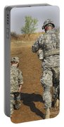 A Young Boy Joins His Squad Leader Portable Battery Charger