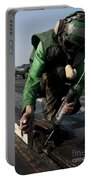 Airman Greases The Catapult Shuttle Portable Battery Charger