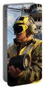 Airman Receives Proper Fire Fighting Portable Battery Charger by Stocktrek Images