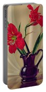 Amaryllis Lillies In A Dark Glass Jug Portable Battery Charger