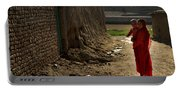 An Afghan Girl Carries Her Little Portable Battery Charger