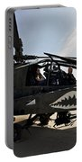 An Ah-64d Apache Helicopter Parked Portable Battery Charger